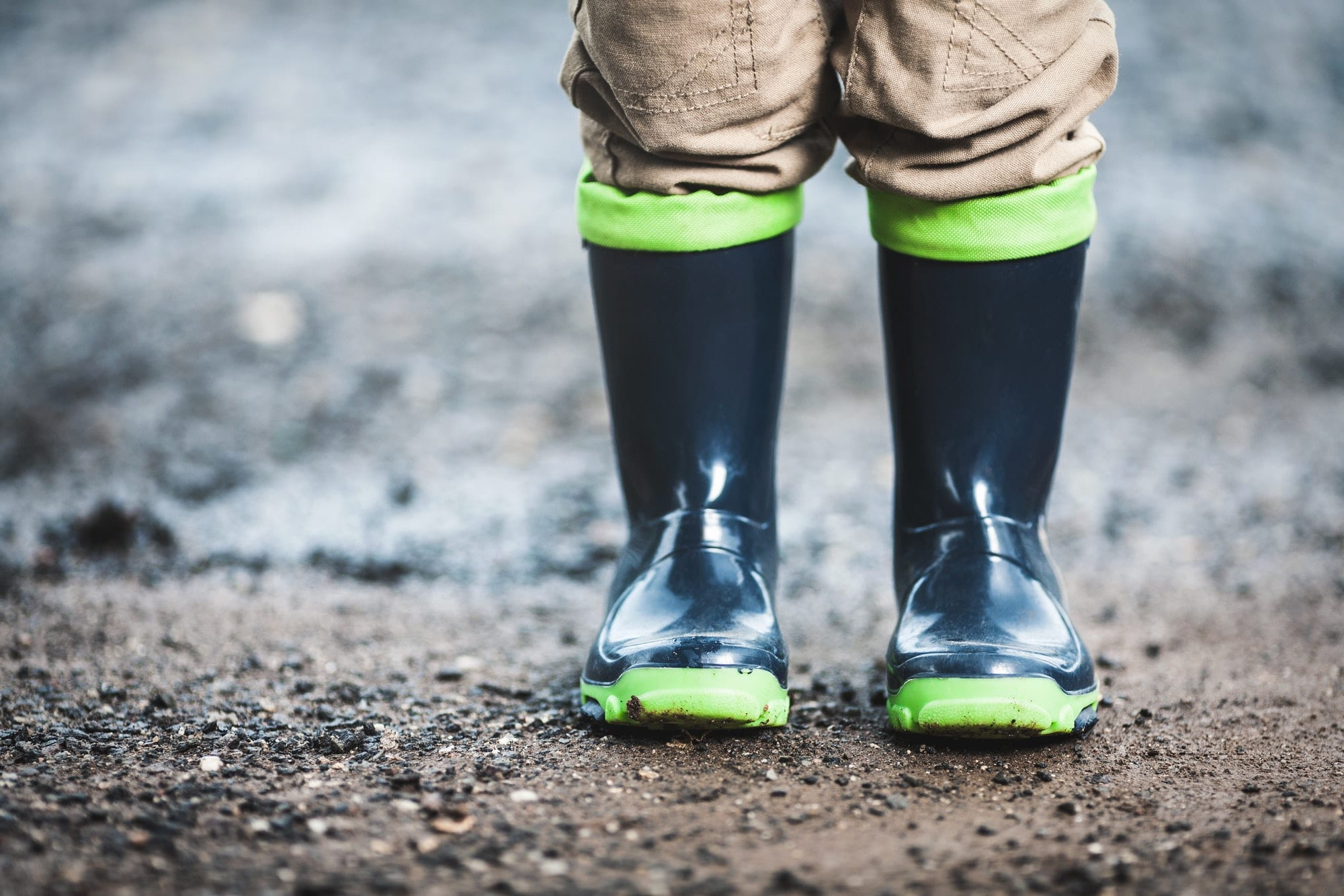 Toddler wearing rubber boots in rainy weather