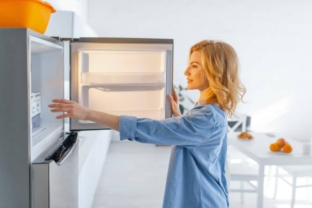 Young woman opened the fridge on the kitchen