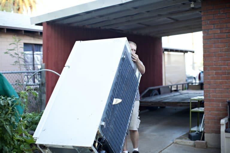 Man moving refrigerator.