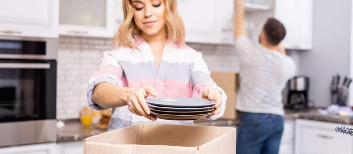 Couple Unpacking in Kitchen